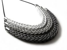 Catirpel is a beautiful, modern, knit necklace that will is a stunning addition to any jewelry collection. This unique knit necklace comes in triple, double, or single tier variations in a number of color combinations.