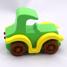 Coming soon to Odin's Toy Factory - Handmade, Handcrafted, Wooden Toy Car, Bad Bob Motors Coupe, Green Acrylic Paint. Yellow Acrylic Paint, White Acrylic Paint, Amber Shellac, Spoked Wheels, Prototype #odinstoyfactoy #Tallahassee #Florida #handmade #handcrafted #woodentoys #toys #car #cars #white #red #green #yellow