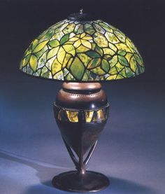 Tiffany Studios, A Woodbine leaded glass and bronze table lamp