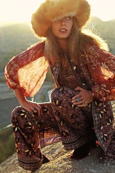 gauzy top, fox fur hat, embroidered pants and chunky jewelry. love.