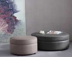 Available in 2 sizes, this is an elegant round footstool, shown in leather with matching stitching and piping but also available in a choice of fabrics.