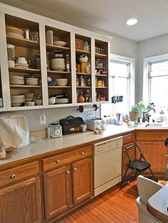 This lovely updated kitchen has a sleek black kitchen island and bright pops of yellow! Kitchen Cabinets And Backsplash, How To Remove Kitchen Cabinets, Small Kitchen Cabinets, Kitchen Cabinet Doors, Kitchen Cabinet Design, Diy Kitchen, Kitchen Decor, Kitchen Ideas, Kitchen Colors