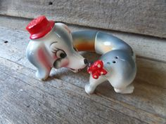 Vintage Dachshund salt and pepper shakers. This little doggie has lots of charm with its design and colors. When I spotted it I had to take it