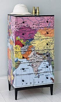 Repurpose large maps. Cover a chest of drawers in a map or atlas