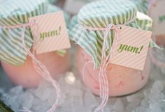 This next idea is perfect for a summer wedding: individual servings of ice cream scooped into mason jars! The seersucker fabric tops make them three times as cute (yep, there's some math for you!).