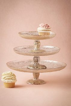 I can see the dessert bar set with multiple heights, it would be gorgous!  Antiquitarian Cake Stand from @BHLDN #BHLDNwishes