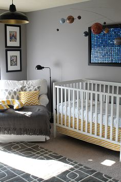 My boys aren't babies anymore, but I like the colors, the comics and the solar system. Cool ideas for a boy bedroom.