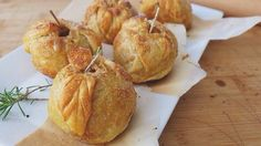 Homemade 'lady' apple pies wrapped in puff pastry --adorned with rosemary stems, handcrafted ornamental leafs, cinnamon-sugar, and core-stuffed caramel. Apple Season, Caramel Apples, Delicious Desserts, Homemade, Cooking, Ethnic Recipes, Apple Pies, Trifles
