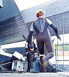 Sam, Josh, and Jen behind the scenes of Catching Fire