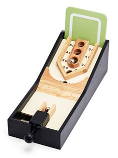 Turn any guy's desk into the office's most popular gathering spot with spring-loaded tabletop Skee-Ball (Jcpenney, $25). Try miniature golf and basketball, too! #giftideas