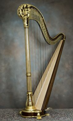 Erard Scroll Top, 47 String Pedal Harp    Unusually fine Erard pedal harp, circa late 1800's. Real rosewood, deeply carved foliate scroll, perfect ormolu decorations.