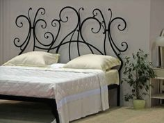 bedroom focus on stunning contemporary wrought iron headboard design and potted indoor plant decor idea