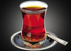 Traditional method of consuming tea in Turkey is in a narrow-waist-ed glass.   One of the biggest tea consumers and producers in the world.   Reason to drink in glass is to show the colours of the tea.