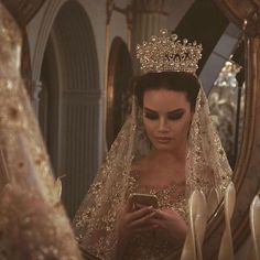 Princess themed wedding. Nice gold crown, matching vail and dress.