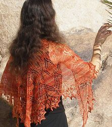 Wear this shawl and look and feel like a million bucks!  Make this beautiful shawl with this free knitting pattern.  Wear it with jeans or work pants to complete your outfit.