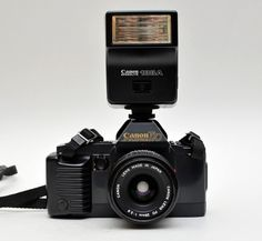 Vintage Canon T70 35mm Film SLR Camera w/ Canon f2.8 50mm FD Lens and Canon 188A Flash by vtgwoo on Etsy