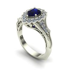 Blue sapphire and diamond pear vintage ring in 18k white gold