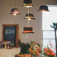 hats hanging as lights - by matthew parker events.  Try using vintage lady's hats for a bridal shower.