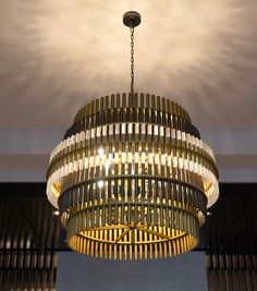 The Vivien Chandelier. With tiers of metal tubes in plated black and satin brass finishes that have been capped with acrylic lenses, this fixture exudes a classic yet architectural aesthetic thats simply stunning. Big Houses, Lenses, Plating, Sweet Home, Chandelier, Brass, It Is Finished, Ceiling Lights, Architecture