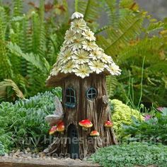 The spring petals fairy house is as fresh as springtime and solar powered to light up the cottage.