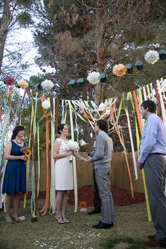 backyard wedding with garlands and streamers