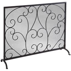 The single-panel version of our elegant triple fire screen. Handcrafted of wrought iron and finished in a deep matte black with dark brown undercoating and an unexpected red brush top coat. Backed with sturdy iron mesh. Beautiful, yes. But also tough. When the sparks fly, this heavy-duty screen serves and protects. Because that's how it scrolls.