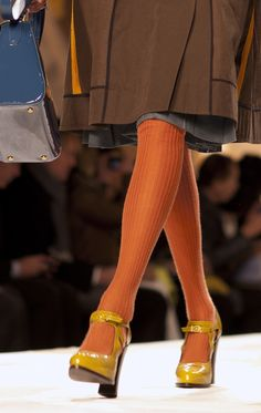 love the orange stockings and yellow maryjanes. i'd wear this in a heartbeat. very urban chic.