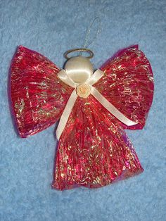 Angel Christmas ornament made from cellophane twisted paper ribbon. Custom made Christmas ornaments give a personal touch as apposed to t...