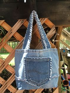 Small to medium denim tote bag that would be by TatteredSisters