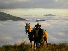 Top 3 Dude Ranch Vacations That You Have To Experience ʊ  http://www.thewondermap.com/dude-ranch-vacations-top-3/ man and horse above the clouds