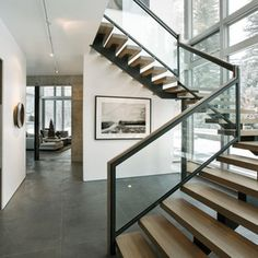 Beautiful contemporary stairs with glass railings...stunning!  www.franksglass.com