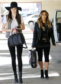 Turning heads: Statuesque model Kendall Jenner towered over her older sister Kim Kardashian as they arrived at the Children's Hospital in LA...