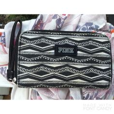 PINK Victoria's Secret Black & White Wristlet Super cute Victoria's Secret Pink Wristlet • In great condition; no stains, rips or tears • dimensions;  6 1/2 inches in length x 4 1/2 inches height • NO TRADES, NO PAYPAL • PINK Victoria's Secret Bags Clutches & Wristlets