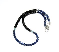 Black tourmaline beads 6x4 mm. Lapis lazuli 5 mm. With sterling silver round beads. Sterling silver hook clasp with moon stone.
