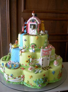Farm animals cake... these colors are perfect for a girl's party...