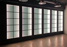 """All NEW Variflex® Glass at """"Am Weinberg Boutique Hotel- Windhoek, Namibia"""". This mobile acoustic partition is finished with superblack melawood frames and obscure, side lit acoustic glass panels."""