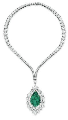 AN EMERALD AND DIAMOND PENDANT NECKLACE, BY HARRY WINSTON Suspending a detachable pendant set with a pear-shaped emerald, weighing approximately 30.19 carats, within a circular and pear-shaped diamond surround, to the graduated circular-cut diamond neckchain, mounted in platinum and gold, 14 ins.