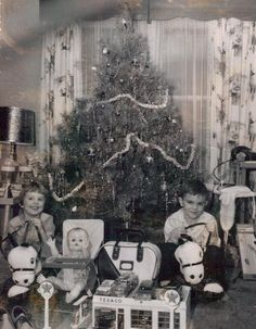 Vintage Christmas tree, with the kids and their presents.