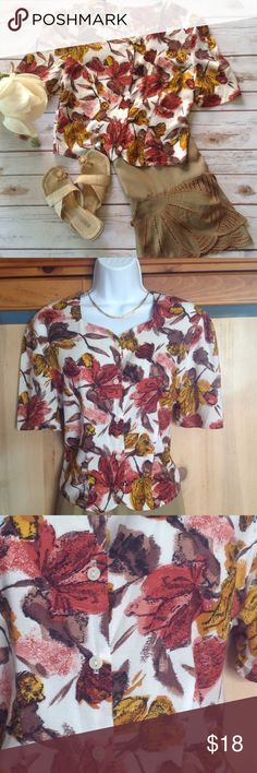 Vintage Cropped Short Sleeve Blouse Cute blouse, probably from the late 1980s, in great shape. Would look sweet with cut off jeans or with the Boho skirt we have listed separately. 100% viscose. Measures 18 inches across from armpit to armpit and 18.5 inches in length. Would probably best fit a size small or size 6. Tops Blouses