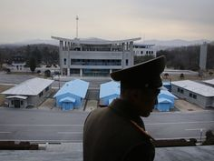 Korean People's Army Lt. Col. Nam Dong Ho is silhouetted