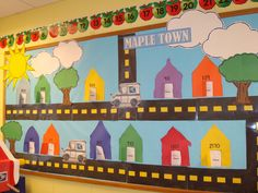 Bulletin board for construction, post office and transportation. Kids made houses with their address on them.
