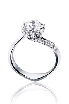 "52 Engagement Rings That Make Saying ""Yes"" Easy  #refinery29  http://www.refinery29.com/fashion-forward-engagement-ring-styles#slide-7  The classic solitaire diamond gets a dramatic twist."