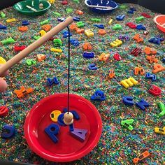"""What letter can you catch? 🎣🌈 Today one of our literacy activities was fishing for letters 🎣🌈 We used our magnetic rods to find magnetic letters in the rainbow rice 🎣🌈 Children were encouraged to use their oral language skills and letter recognition skills as they shared with their peers """"I caught a __ !"""" 🎣🌈 Lots of fine motor and hand eye coordination practice too! 🎣🌈 #learningthroughplay"""