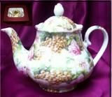 Ashley 5 Cup Porcelain Teapot is a hand decorated item where you can select from the drop down box the pattern you would like the crafter to use. Each item is decorated at the time of the order just for you. FDA approved and trimmed in 14K gold.