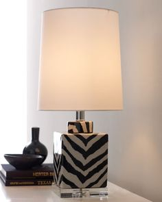 This ginger-jar style zebra lamp is the kind of decor devise that can offer light but also a touch of eye-catching graphic when dispersing  texture throughout a room