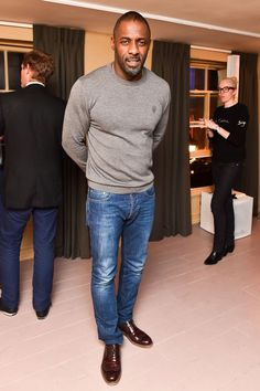 Wearing a crew neck jumper, brown lace-ups and just-the-right-side of distressed jeans to the La Maison Remy Martin members club in London. This is dressed-down done right.%0AVote for Idris Elba to win GQ Readers' Best-Dressed Man in Britain here.