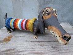 This sculpture of a dachshund measures 40 cm x 16 cm x 17 cm / 15.7 x 6.3 x 6.6 and weighs 1.7 kg / 3.7 lb The sculpture was made of fireclay, colored with metal oxides and fired at °C 1050 in an electric kiln. It has felt stickers on its soles. No molds were used, it is a