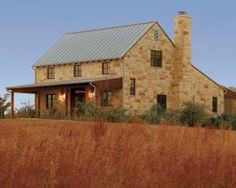 Metal roofing and rustic stone walls create a rugged patina for this new old house in Texas. I like the stone. Stone Exterior Houses, Old Stone Houses, Exterior House Colors, Exterior Design, Stone House Plans, Limestone House, Hill Country Homes, Country Cottages, Texas Hill Country