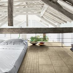 A loft bedroom with a modest eastern design