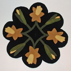 Spring Daffodils Wool Applique Table Mat Black by ecoughlindesigns